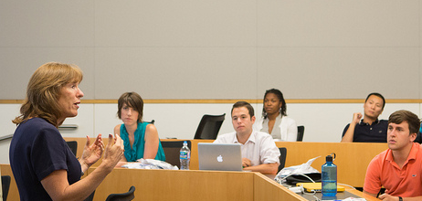 Professor lecturing to students.