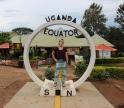 Elena Mieszczanski posing for a photo at the equator in Uganda.