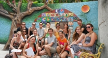 Students posing in colorful garden in Cuba!