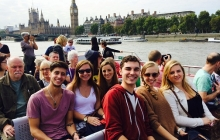 Students on a boat tour of the River Thames.