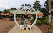 Elena Mieszczanski posing for a photo at the equator in Uganda.