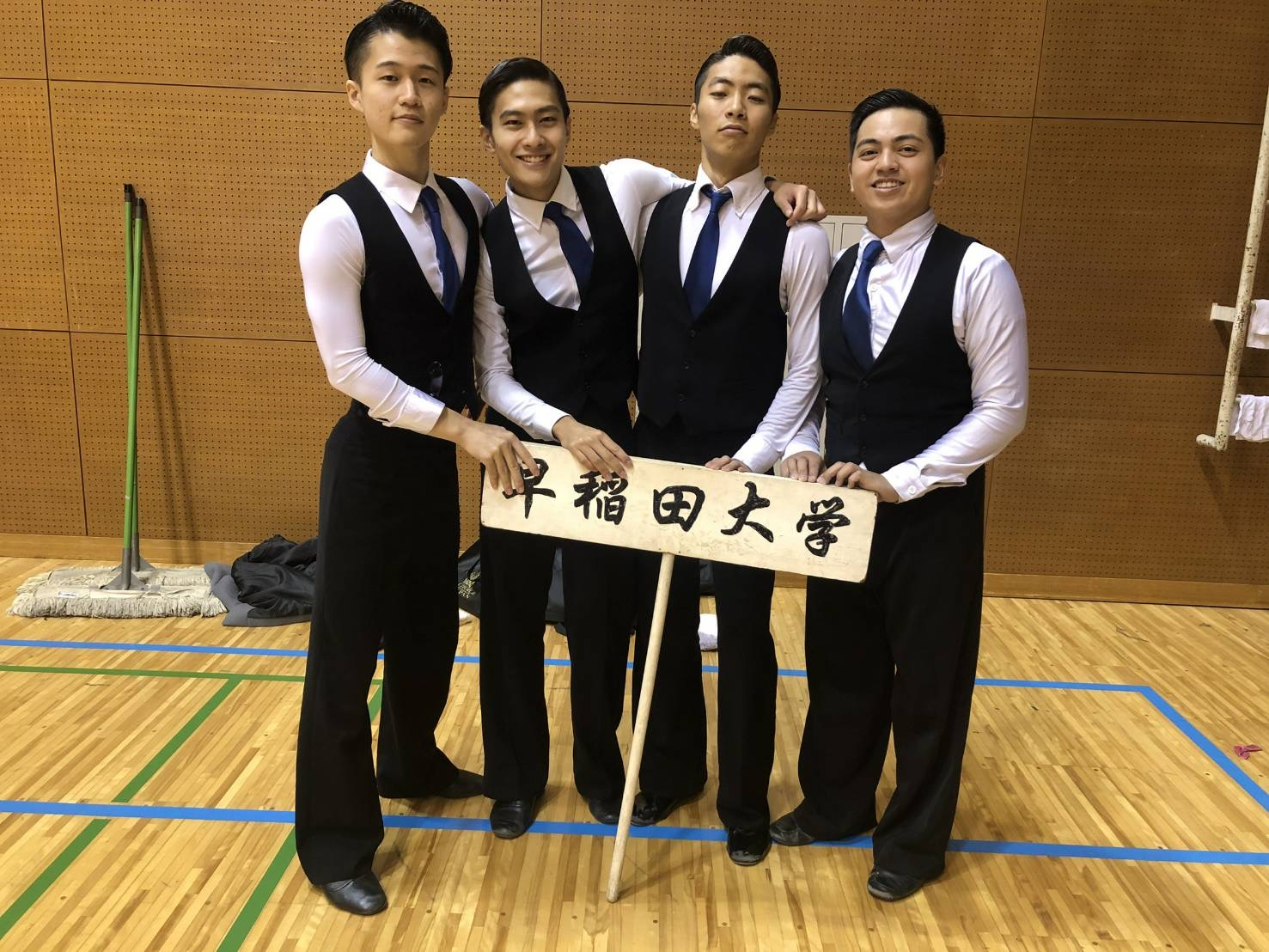 GW student Lorenz Vargas posing with members of the Waseda University Ballroom Dance Club.