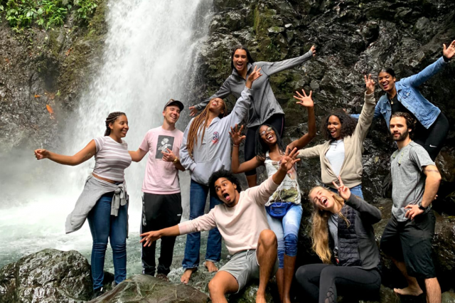 GW student Audrey Friedline posing with other students near a waterfall in Colombia.